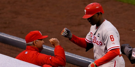 DENVER, CO - MAY 20:  Ryan Howard #6 of the Philadelphia Phillies is congratulated in the dugout by Manager Ryne Sandberg of the Philadelphia Phillies after he hit a solo home run during the second inning against the Colorado Rockies at Coors Field on May 20, 2015 in Denver, Colorado. (Photo by Justin Edmonds/Getty Images)