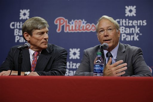 Veteran baseball executive Andy MacPhail, right, speaks during a news conference with Philadelphia Phillies part-owner John Middleton before a baseball game against the Milwaukee Brewers, Monday, June 29, 2015, in Philadelphia. (AP Photo/Matt Slocum)