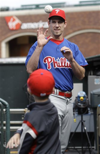 Cliff Lee plays catch in the dugout with his son Jaxon, 8, before a game against the Giants on July 30, 2009.